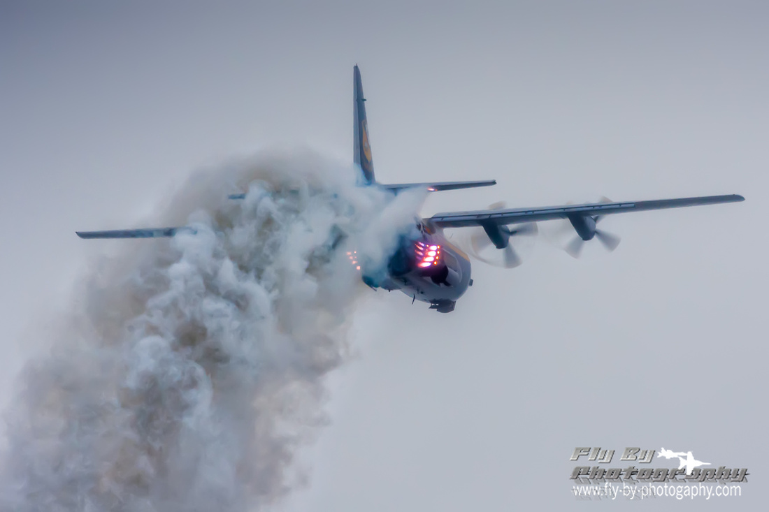 The Blue Angels' C-130, Fat Albert riding a plume of rocket flame and exhaust during a JATO take-off.