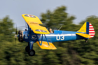 David Brown swoops in on the field during an aerobatic flight.