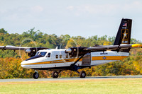 The Black and Gold de Havilland Canada Twin Otter taxis to the ramp.