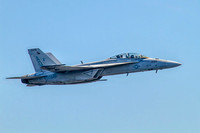 US Navy F/A-18F Super Hornet strike fighter aircraft from squadron VFA-106 flying over Baltimore, Md