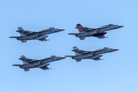 F-18E fighter aircraft of VFA-31 Tomcatters in formation, flying over Fort McHenry