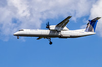 United Express (Colgan Air) De Havilland Canada DHC-8-402Q photograped landing at Dulles International Airport.
