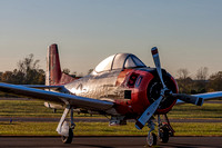 Early morning photo of a T-28 Trojan, of the Trojan Horsemen Demonstration Team covered in dew, bathed in the golden sunlight.