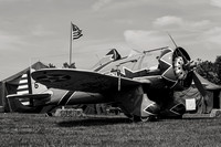 A black and white photo of a Boeing P-26 Peashooter at Warbirds Over the Beach. The P-26 was a pre-World War II, U S Army Air Corps fighter plane.
