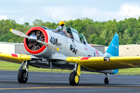 Members of the Commemorative Air Force's Capital Wing arrive with a T-6 Texan trainer.