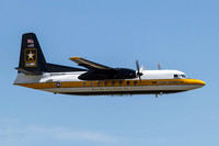 The U.S. Army Golden Knights Parachute Team's C-31 Troopship makes a low pass.