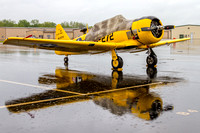 I used the soaked pavement to photograph this mirror image of a T-6 Texan.