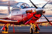 A Navy Texan II on the Manassas airport ramp photographed at sunrise