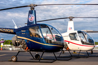 A pair of American Helicopters owned R-22 Beta II helicopters on display at the Leaseweb Manassas Airshow.