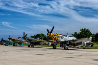 Allied fighters at Warbirds Over the Beach including a US P-51 Mustang, a British Spitfire and Hurricane and a Soviet Yak-9.