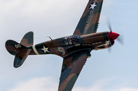 Thom Richard in the P-40 tearing up the skies over the Mid-Atlantic Air Museum's World War II Weekend airshow.