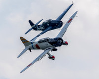 The Japanese Val dive bomber and the CAF Capital Wing's TBM Avenger during the Battle Of The Pacific portion of the Mid-Atlantic Air Museum's World War II weekend.