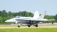 F-18C Hornet of VFA-15 Vallions, callsign Pride, taxis toward the runway at NAS Oceana.