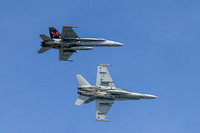 A pair of F-18Cs of VFA-87 Golden Warriors, callsign War Party, breaks for landing over NAS Oceana, Apollo Soucek Field.