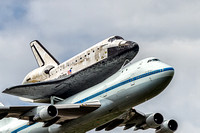 Close up view of Space Shuttle Discovery flying on the back of NASA's 747 transport aircraft