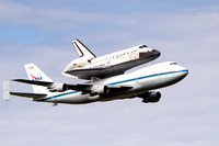 Space Shuttle Discovery on the back of her transport aircraft the NASA 747 flying by the Smithsonian's Udvar-Hazy facility