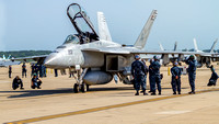 Sailors assigned to VFA-213 Blacklions insure a clean bill of health for their Super Hornet.